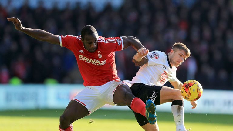 Michail Antonio battles with Jamie Ward for the ball
