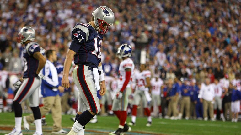 Brady trudges off the field after defeat to the Giants in Super Bowl XLII