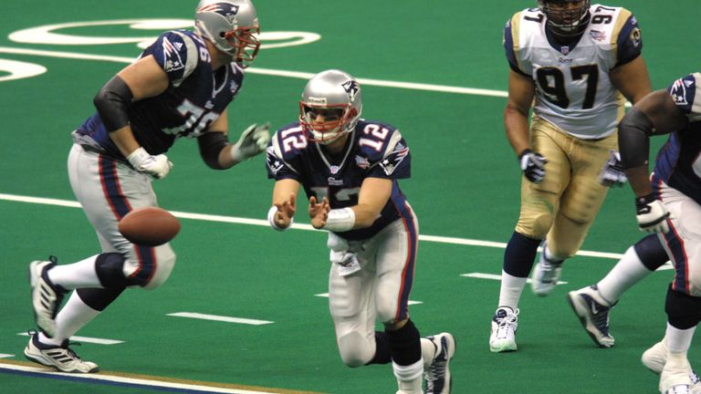 Quarterback Tom Brady #12 of the New England Patriots  passes the ball during the game against the St.Louis Rams at Superbowl XXXVI at the Su