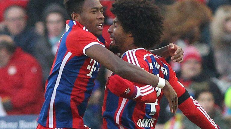 Bayern Munich's David Alaba (l) celebrates with Dante