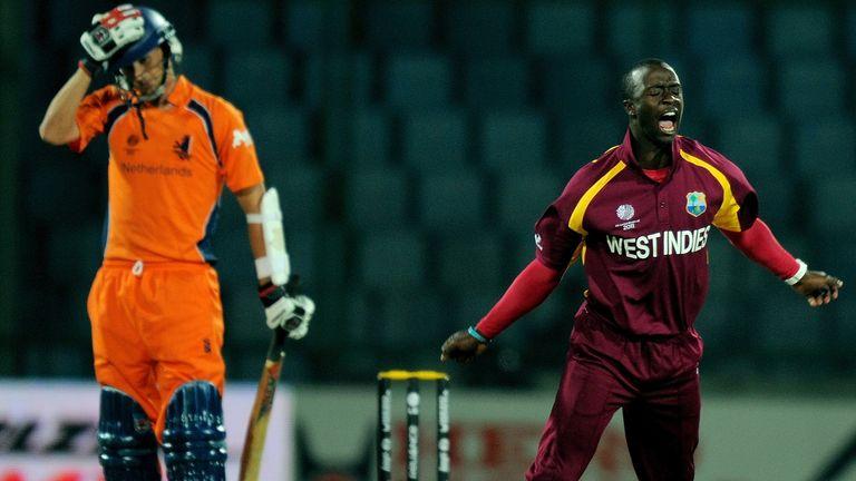 Kemar Roach bellows in delight after picking up Pieter Seelaar's wicket