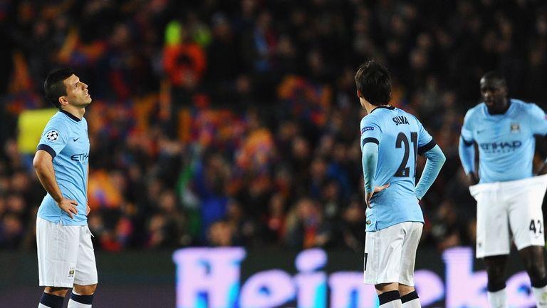 City players look dejected after Ivan Rakitic's goal
