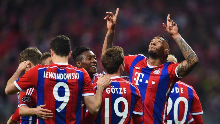 Jerome Boateng of Bayern Munich celebrates with team mates