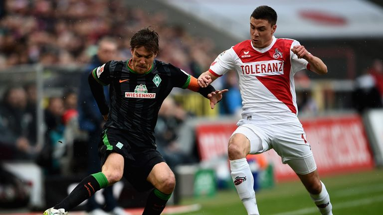 Clemens Fritz of SV Werder Bremen and Jonas Hector of 1. FC Koeln battle for the ball