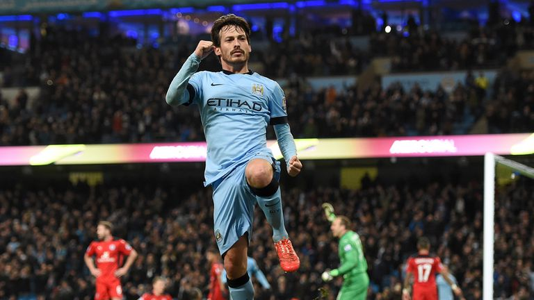 Manchester City's David Silva celebrates opening the scoring against Leicester