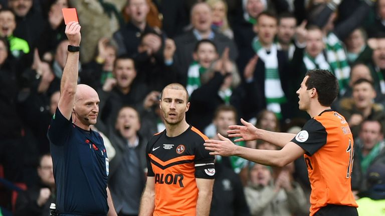 Dundee United's Sean Dillon is shown the red card