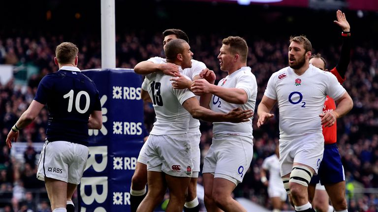 Jonathan Joseph of England celebrates after scoring England's first try