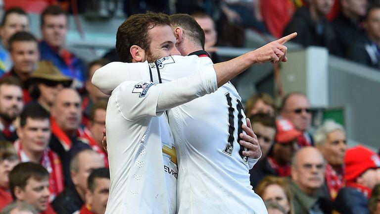 Juan Mata celebrates after scoring his first