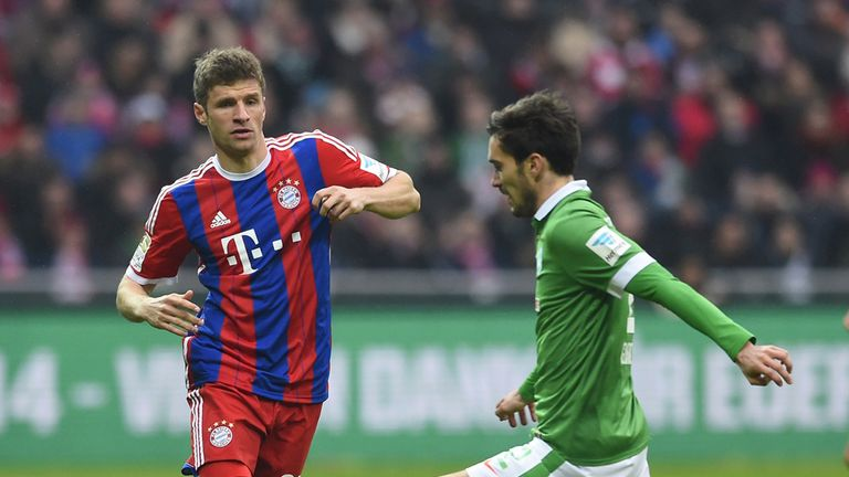 Thomas Muller gets the better of Santiago Garcia