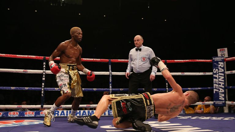 Zolani Tete knocks down Paul Butler in their IBF Super-Flyweight Championship of the World fight at the Echo Arena, Liverpool.