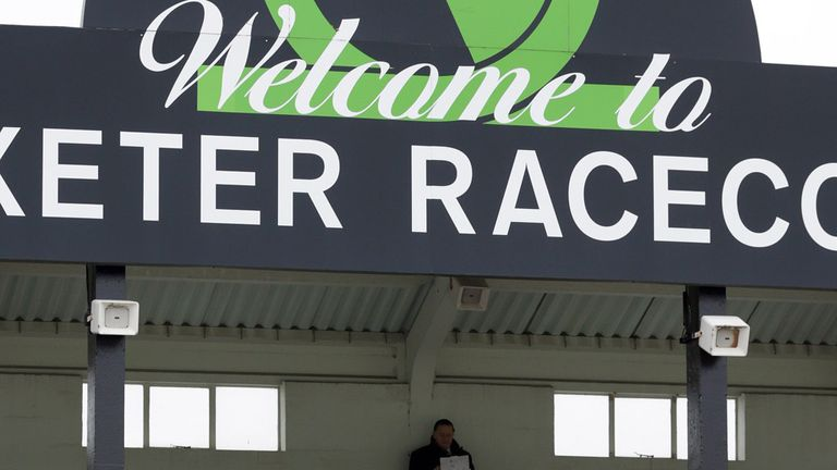 A racing fan sits in one of the stands at Uttoxeter Racecourse