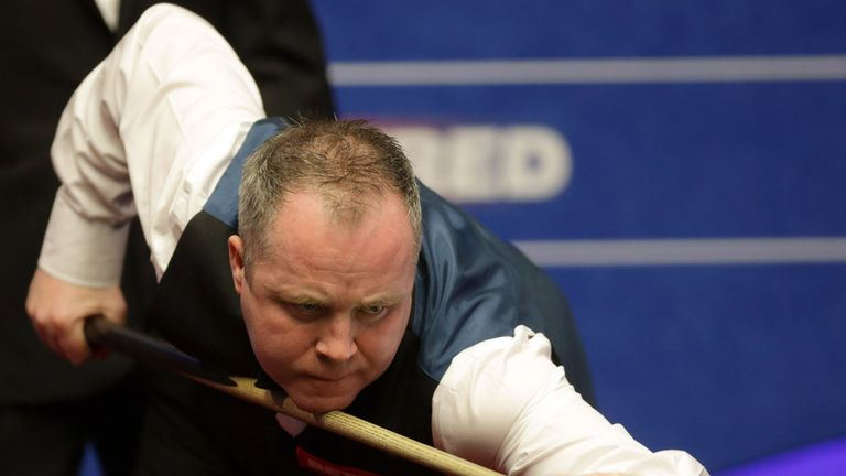John Higgins of Scotland in action against Robert Milkins of England at the Betfred World Snooker Championship