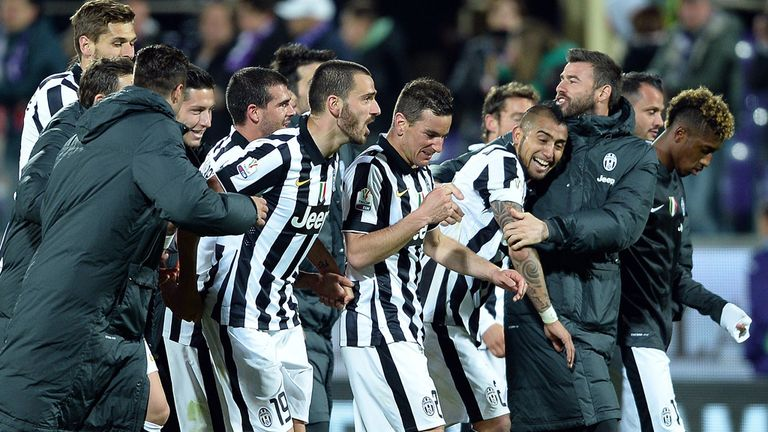 Juventus players celebrate reaching the Coppa Italia final by beating Fiorentina