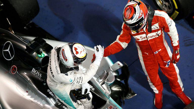 Lewis Hamilton and Kimi Raikkonen congratulate each other in parc ferme