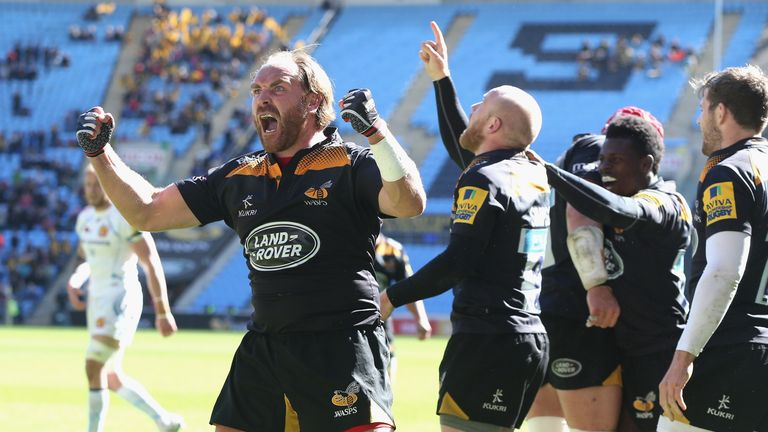 Wasps fly-half Andy Goode celebrates Joe Simpson's late try against Exeter