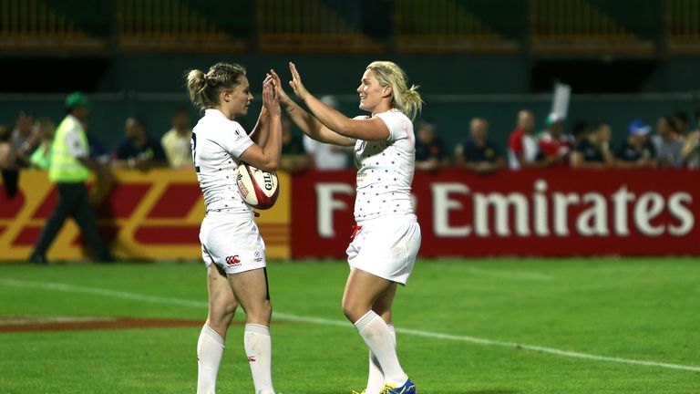 Natasha Hunt of England is congratulated after scoring the winning try against Fiji