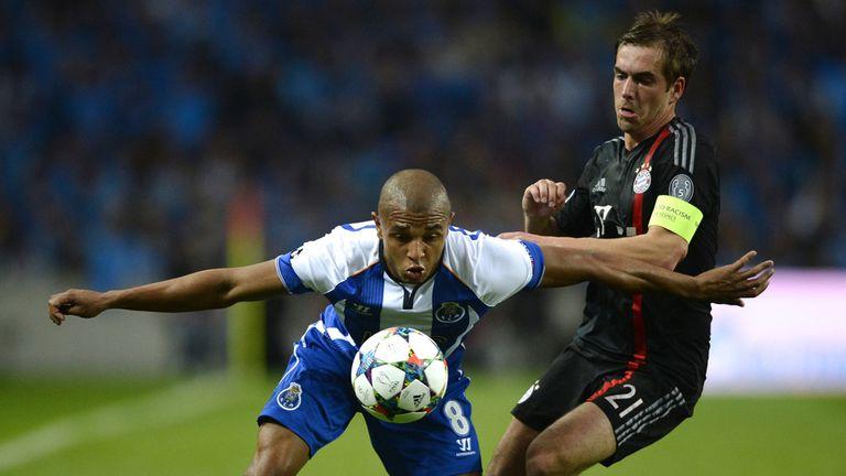 Yacine Brahimi keeps the ball away from Philipp Lahm
