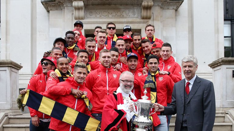Arsene Wenger and his Arsenal team took the FA Cup to Islington Town Hall.