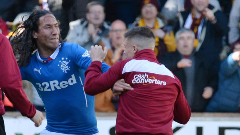 Rangers' Bilel Mohsni (centre) clashes with Motherwell players at Fir Park