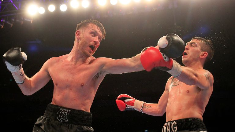 Cardle (left) in action against Craig Evans