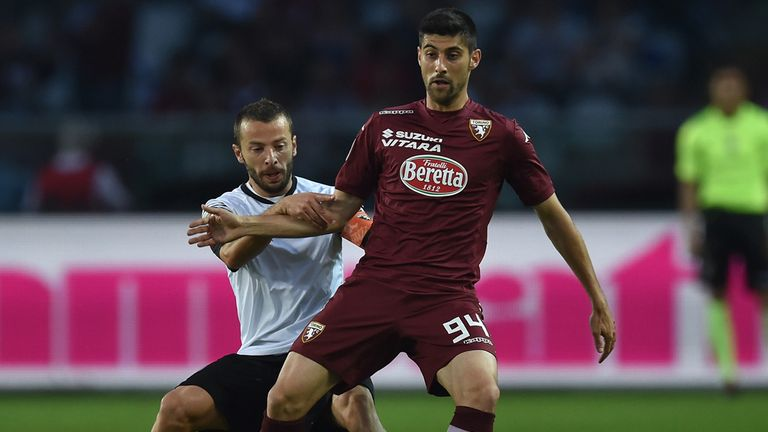 Marco Benassi (right) of Torino is challenged by Giuseppe De Feudis of Cesena