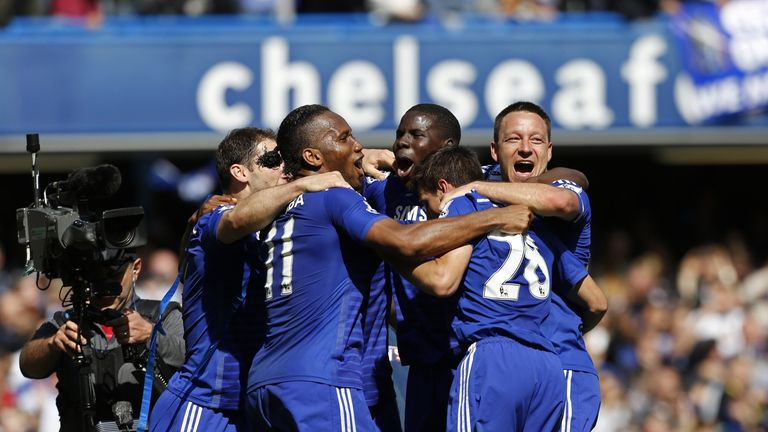 Chelsea players celebrate their title triumph after the final whistle against Crystal Palace
