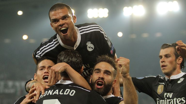 Real Madrid celebrate the equaliser, scored by Cristiano Ronaldo