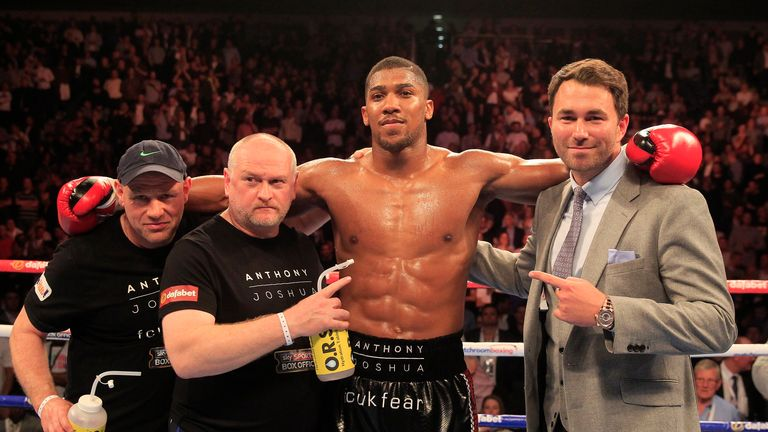 Joshua celebrates with promoter Eddie Hearn (Pic by Lawrence Lustig)