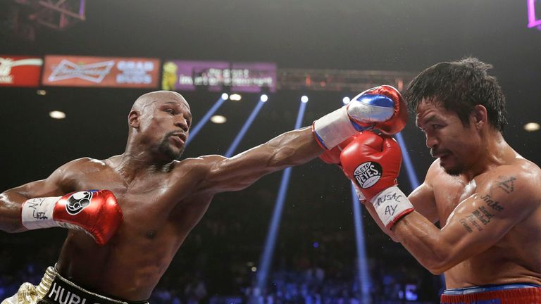 Floyd Mayweather Jr (left) trades blows with Pacquiao in their superfight in May