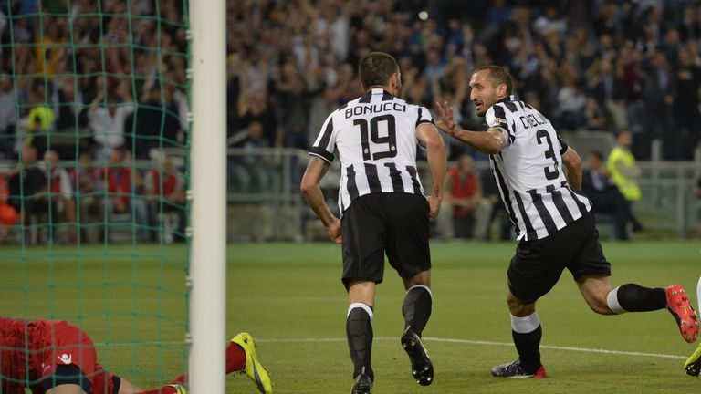 Giorgio Chiellini wheels away in celebration after his equaliser for Juventus