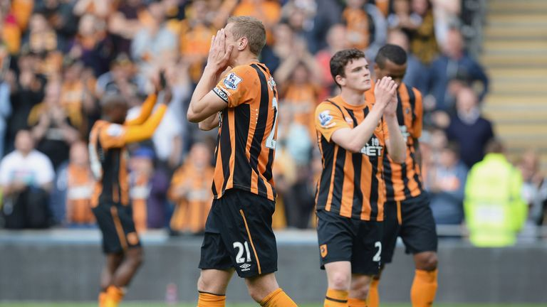 Michael Dawson and the Hull City players show their dejection