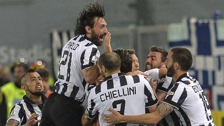 Juventus' forward Alessandro Matri (hidden) celebrates with team-mates