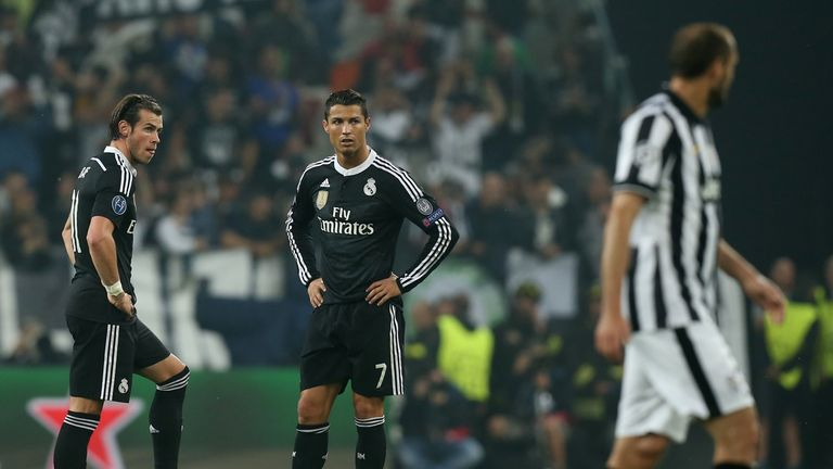 Ronaldo stands with team-mate Gareth Bale during their defeat by Juventus in the Champions League last season