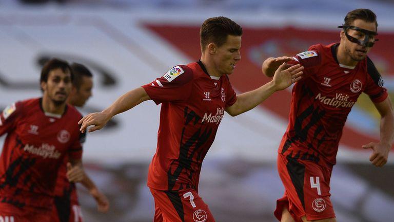 Sevilla's Kevin Gameiro celebrates with Polish midfielder Grzegorz Krychowiak