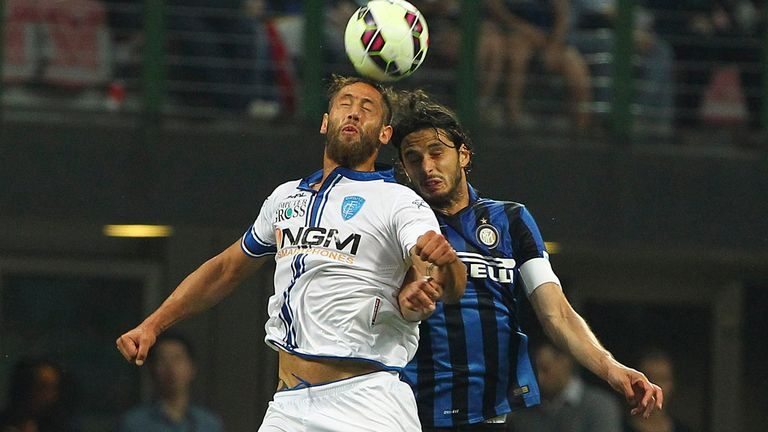 Levan Mchedlidze of Empoli competes for the ball with Inter's Andrea Ranocchia