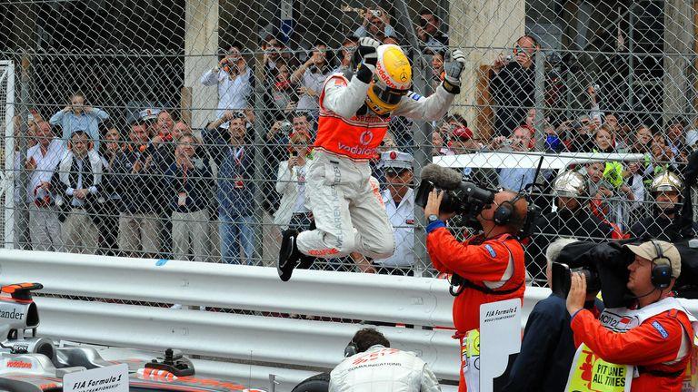 Hamilton celebrates winning the Monaco GP for the first time