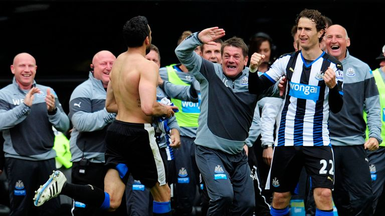 John Carver celebrates with Jonas Gutierrez during a 2-0 win over West Ham that ensured Newcastle's survival in 2015