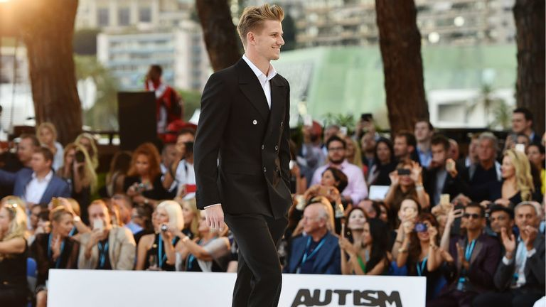 Nico Hulkenberg on the catwalk at the Monaco fashion show