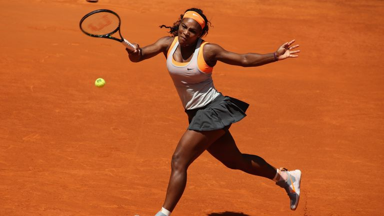 Serena Williams of the United States plays a forehand against Carla Suarez Navarro
