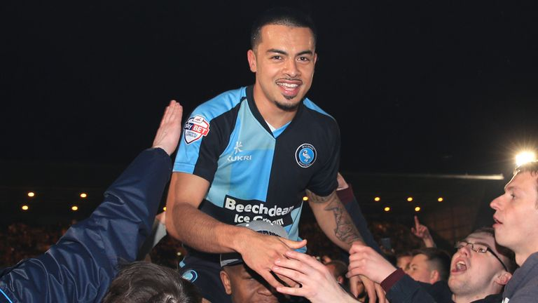 Wycombe Wanderers' Nicholas Yennaris is lifted by celebrating fans