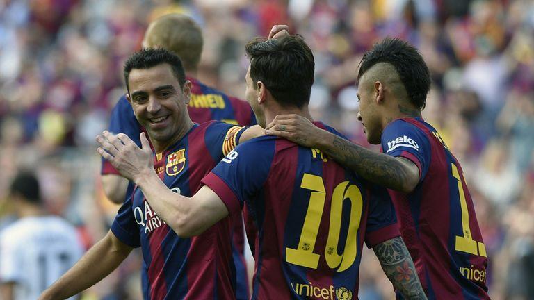 Xavi, Lionel Messi and Neymar celebrate