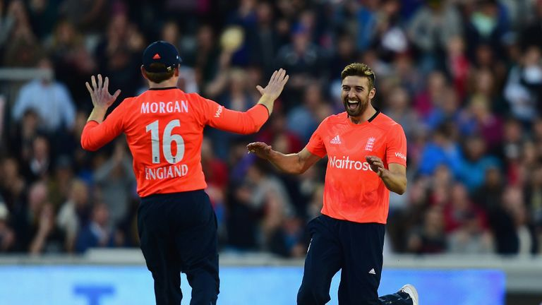Mark Wood celebrates one of his three wickets with Eoin Morgan