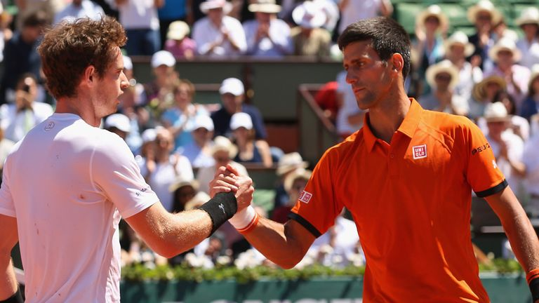 Andy Murray congratulates Novak Djokovic after defeat in their Men's semi-final match