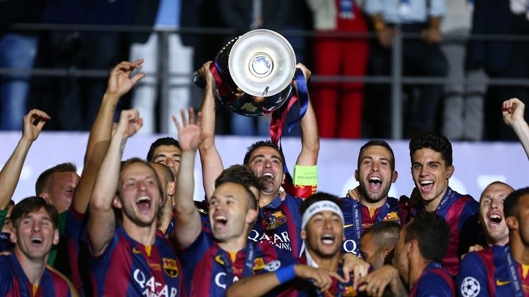 Xavi of Barcelona lifts the trophy