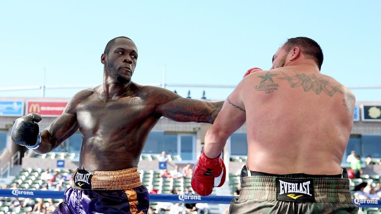 Deontay Wilder (L) is another world champion on Briggs' radar