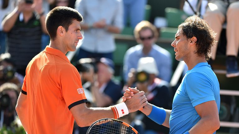 Nadal (right) was humbled at Roland Garros by his long-time rival Novak Djokovic (left)