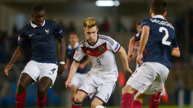 Dayot Upamecano (left) battling for the ball with Germany's Johannes Eggestein