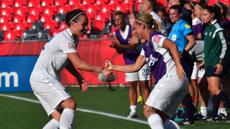 England's Jordan Nobbs (R) celebrates with goal-scorer Lucy Bronze after her winner