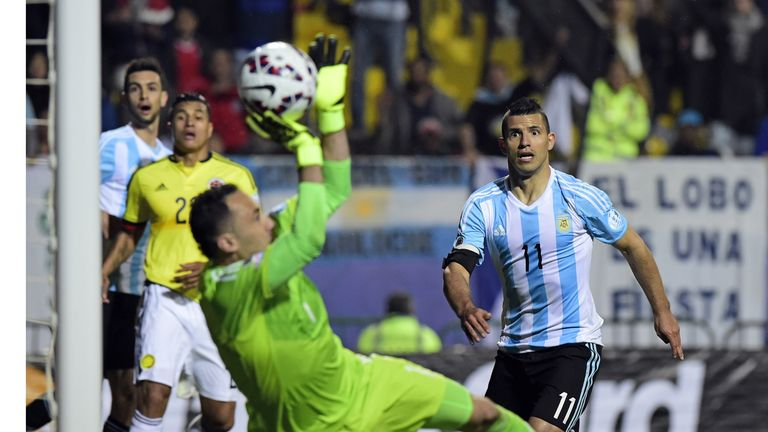 Colombia's David Ospina denied Lionel Messi as Sergio Aguero looked on