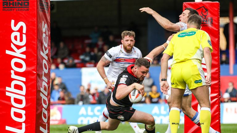 Sam Hopkins scores a try against Wakefield in the Challenge Cup